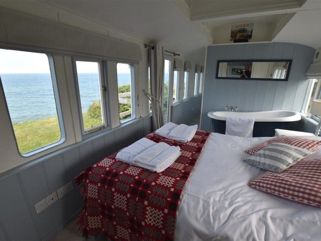 Cosy double bedroom with bath