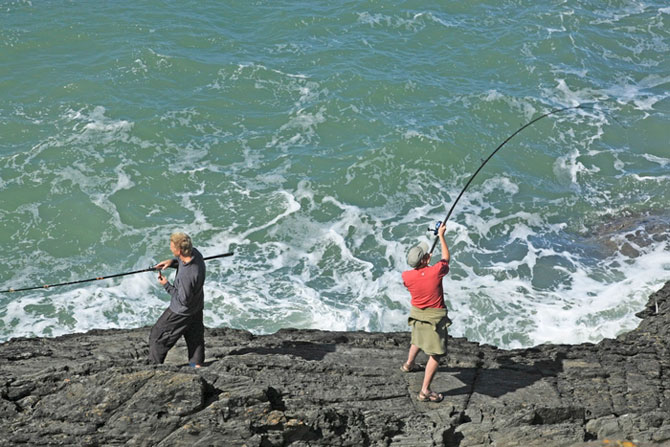 Sea Fishing from rocks at Mwnt Cardigan Bay by Janet Baxter