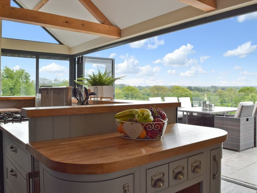Five bed-roomed holiday farmhouse bi-fold doors leading to patio.