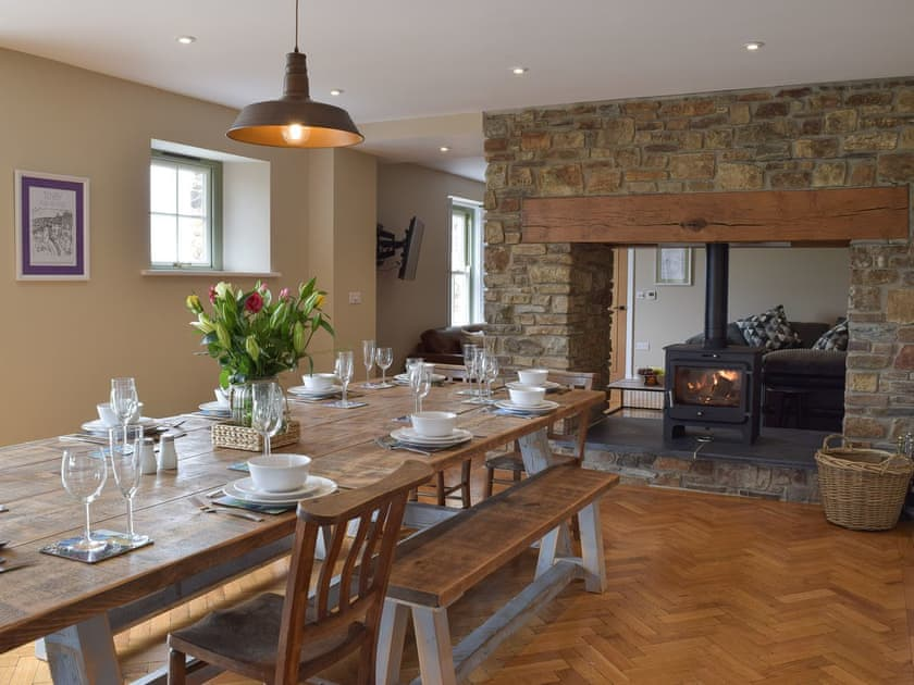 Open plan living space with wood-burner