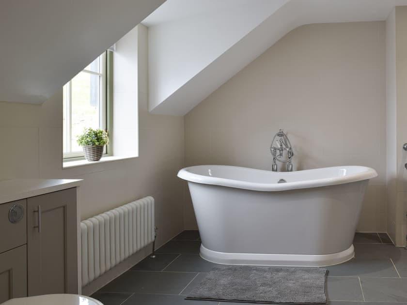 Roll top bath and underfloor heating